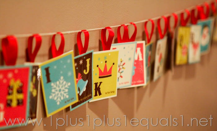 Hanging up christmas cards christmas lights card and decore for 1 plus 1 equals window
